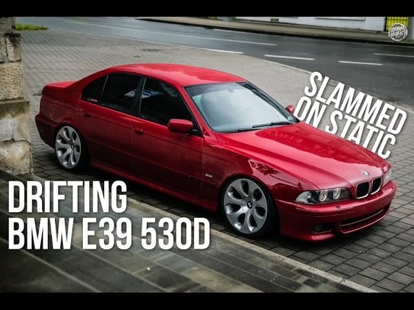 Garcia drifting slammed BMW e39 530d red on 19 style 121 wheels